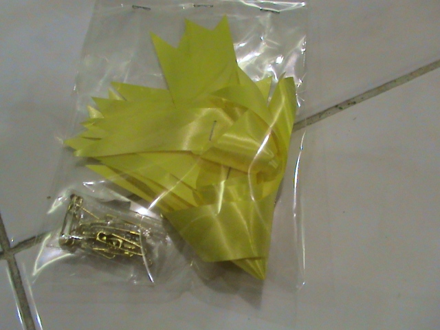 kode kostum pita kuning