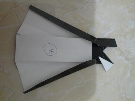 26. lipat segitiga atas sebagai lengan kanan